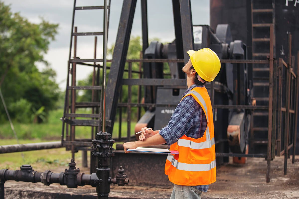 workers-standing-checking-beside-working-oil-pumps (2)