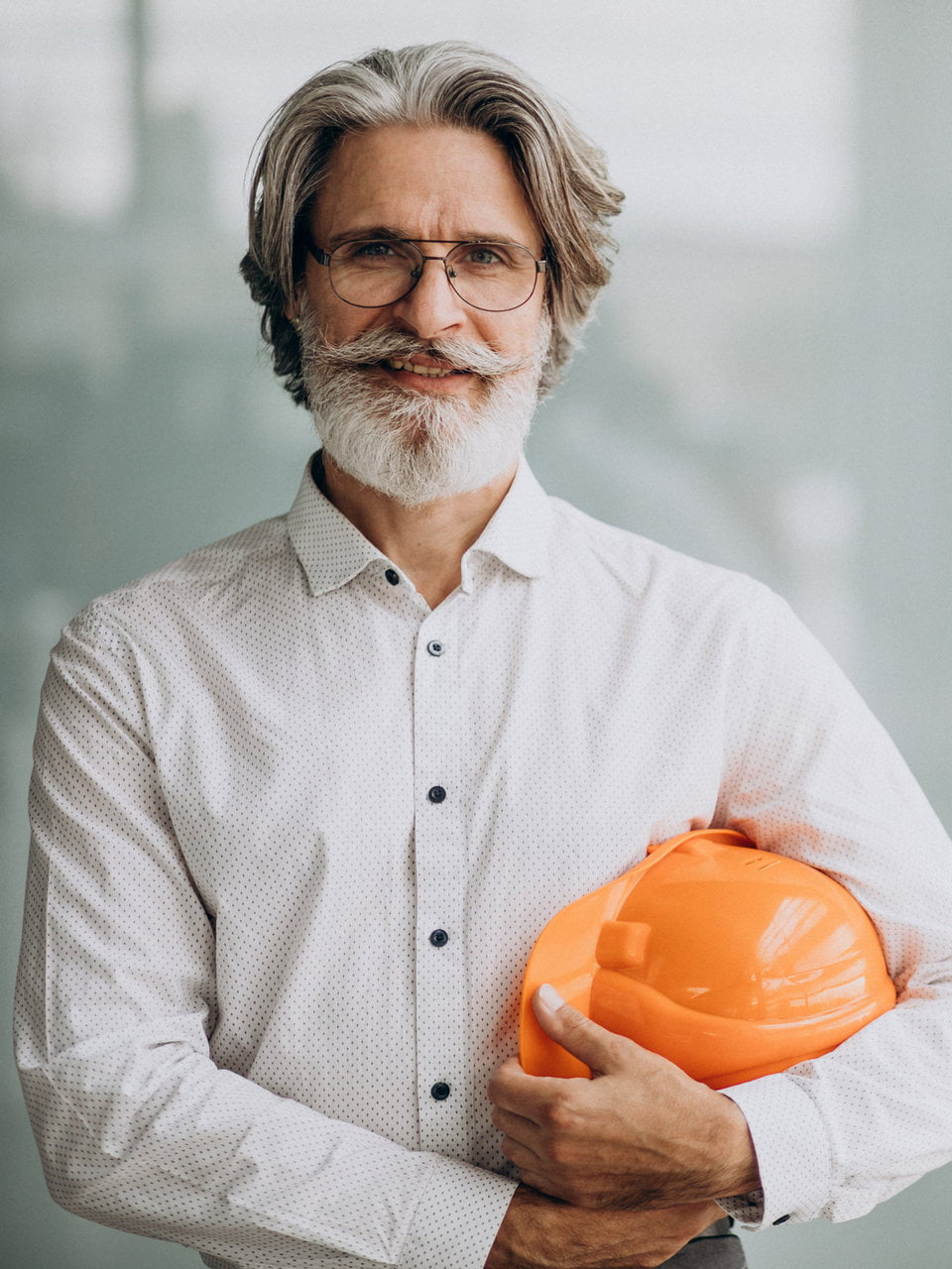 Middle aged business man in a hard hat